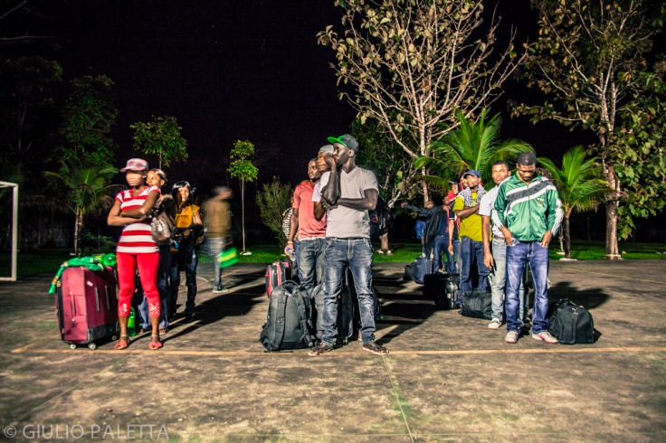 Haitians and Senegaleses, ready with their bags for the long trip to São Paulo patiently wait the bus to arrive at the refugees center in Rio Branco. Acre government every week rents 2,3 buses to take those immigrants who already got the necessary documents, to São Paulo, a 4 days trip