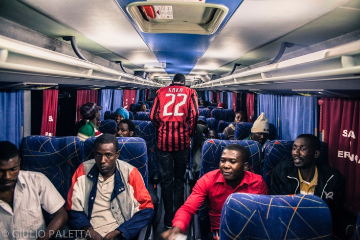 Inside the bus. Haitians and Senegaleses, ready with their bags for the long trip to São Paulo patiently wait the bus to arrive at the refugees center in Rio Branco. Acre government every week rents 2,3 buses to take those immigrants who already got the necessary documents, to São Paulo, a 4 days trip